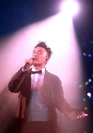 "Eason Chan performs during his ""Duo"" concert in Hong Kong on March 20,"