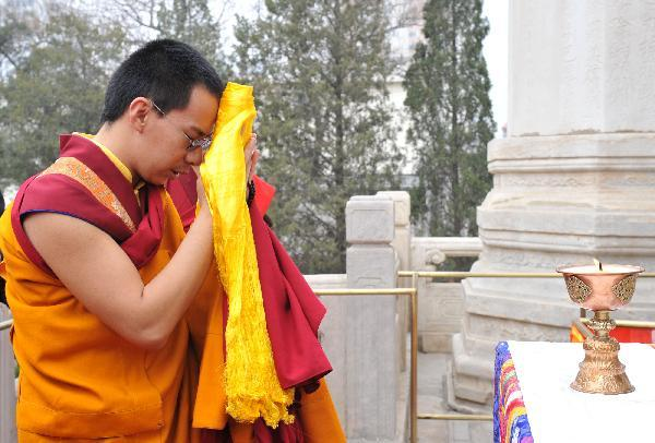 Bainqen Erdini Qoigyijabu, the 11th Panchen Lama, also vice president of the Buddhist Association of China, attends a prayer ritual for the victims in the devastating earthquake in northwest China, in Beijing, China, April 20, 2010. Bainqen Erdini Qoigyijabu and Jamyang Losang Jigme Tubdain Qoigyi Nyima, a living Buddha and vice president of the Buddhist Association of China, hold the prayer ritual together on Tuesday. (Xinhua/Huang Jingwen)