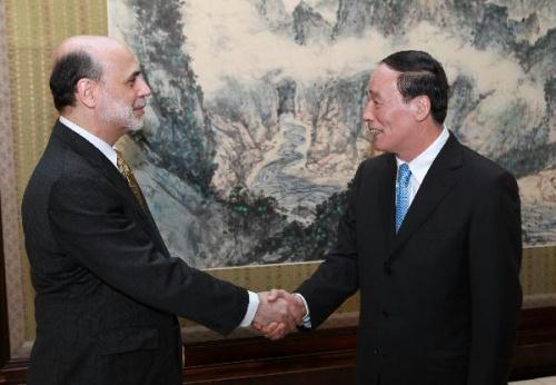 Chinese Vice Premier Wang Qishan (R) meets with U.S. Federal Reserve Chairman Ben Bernanke in Beijing, capital of China, May 23, 2010. (Xinhua/Pang Xinglei)