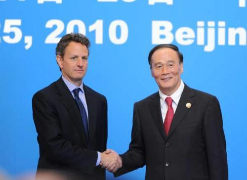 Chinese Vice Premier Wang Qishan (R) shakes hands with U.S. Treasury Secretary Timothy Geithner during the economic track of the second round of China-U.S. strategic and economic dialogue in Beijing, capital of China, May 24, 2010. (Xinhua Photo)