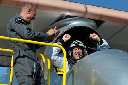 Solar Impulse's team chief Bertrand Piccard, left and Solar Impulse's Chief Executive Officer and pilot Andre Borschberg celebrate after successfully landing the solar-powered HB-SIA prototype airplane after its first successful night flight attempt at Payerne airport on Thursday, July 8, 2010.(Xinhua/Reuters Photo)