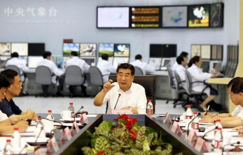 Chinese Vice Premier Hui Liangyu (facing camera) presides over an emergency meeting of the State Flood Control and Drought Relief Headquarters in Beijing July 10, 2010.(Xinhua/Ding Lin)