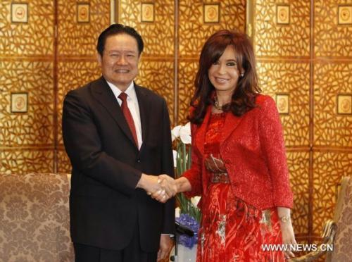 Zhou Yongkang (L), a member of the Standing Committee of the Communist Party of China (CPC) Central Committee Political Bureau, meets with Argentine President Cristina Fernandez de Kirchner in Beijing, China, July 14, 2010.(Xinhua/Ding Lin)
