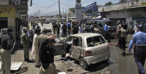 Pakistani security officials and rescue workers survey the site of a suicide bomb attack in Mingora, Swat July 15, 2010.  Casualties in the suicide blast in Mingora on Thursday have risen to 50, local media reported.  (Xinhua/Reuters Photo)