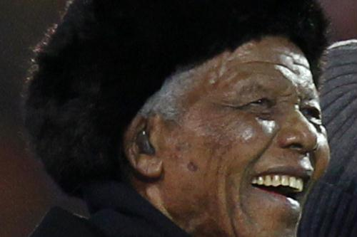 Former South African President Nelson Mandela smiles at Soccer City stadium during the closing ceremony for the 2010 World Cup in Johannesburg July 11, 2010.(Xinhua/Reuters File Photo)