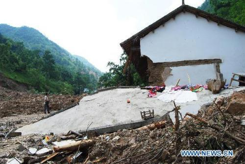 Photo taken on July 27, 2010 shows the house destructed in mud-rock flow in Qiaoergou Village of Shanyang County, northwest China's Shaanxi Province. The rain-triggered mud-rock flow hit Qiaoergou Village on July 24, burying 29 people. As of Tuesday, six people were killed, five were seriously injured and 18 remained missing. About 530 villagers have been evacuated. (Xinhua/Chen Changqi)
