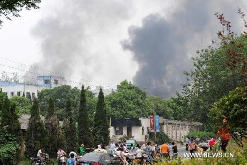 Smokes are seen near a factory in Nanjing, capital of east China's Jiangsu Province, July 28, 2010. A powerful explosion hit a factory in northern Nanjing Wednesday, killing a yet-unknown number of people and injuring many more, witnesses and hospital sources said.(Xinhua/Yang Lei)