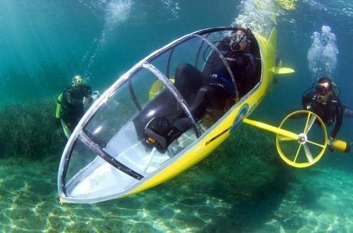 Stephane Rousson, chief designer of the Scubster submarine, a pedal-powered personal wet sub, is seen underwater during testing in Villefranche sur Mer, southeastern France, July 28, 2010. Rousson will attend the upcoming International Submarine Race in Bethesda in Maryland, U.S, June 2011. The streamlined carbon fiber Scubster, build by Rousson, moves up to the desired 10kph (6.2mph) speed, and 5 meters (16 feet) in the depths of the sea. Scubster team will take part in next year's International Submarine Race, which is scheduled to be held at the Naval Surface Warfare Center-Carderock Division, Bethesda, Maryland between June 27 and July 1, 2011. (Photo Source: china.com.cn)