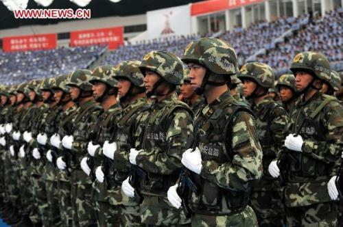 Policemen of public security border defence line up during a gathering to vow for the security mission of 16th Asian Games in Guangzhou, south China's Guangdong Province, Aug. 4, 2010. Aug. 4 is the 100-day countdown to the Asian Games. (Xinhua/Liu Dawei)