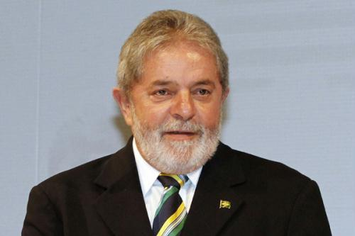 Brazil's President Luiz Inacio Lula da Silva gives a thumbs-up during a Brazil-Italy business conference at the FIESP in Sao Paulo June 29, 2010.(Xinhua/Reuters File Photo)