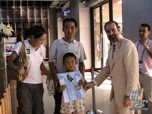 The Argentina Pavilion presents its 2 millionth visitor with a gift pack on Sunday.