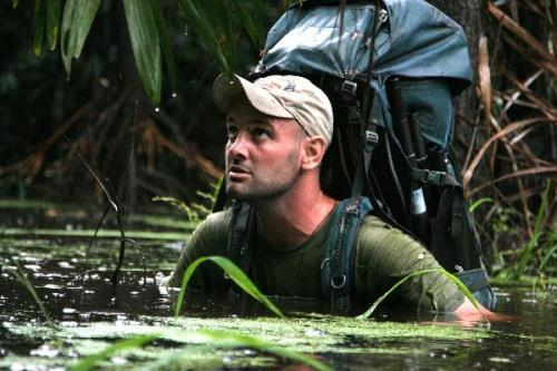 "Ed Stafford of Leicestershire, England, walks in between trees as he walks through the Amazon jungle in Brazil in this undated handout photo. Former British army captain Stafford became on Monday the first known person to walk from the origin of the Amazon river, the world's second-longest river, to its mouth, after withstanding ""50,000"" mosquito bites, scorpion attacks and skin disease in his 859 day odyssey. (Xinhua/AFP Photo)"