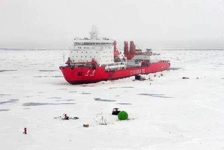 "Photo taken on Aug. 16, 2010 shows China's ""Xue Long"", or ""Snow Dragon"", icebreaker in the North Pole. The Chinese fourth scientific expedition team to the North Pole has established an observation station on an ice area at 86.55 degrees north latitude to conduct joint research in ocean, atmosphere as well as ice conditions. (Xinhua photo)"