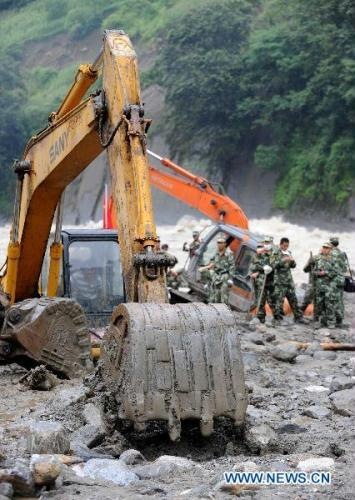 Rescuers work in Puladi Town, Gongshan of southwest China's Yunnan Province, Aug. 22, 2010. The death toll of the mudslides in Gongshan has risen to 29, with 63 others still missing as of 6:00 p.m.Sunday, said local authorities.(Xinhua/Lin Yiguang)