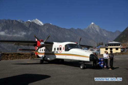 The file photo taken on Dec. 3, 2009 shows a plane of Agni air parking at the Lukla airport, east of Kathmandu, capital of Nepal. A small plane of Agni Air has crashed in Makwanpur district, southwest of Kathmandu, in central Nepal early Tuesday morning, killing 15 people, local media reported. The exact cause of the accident is not known, but officials suspect bad weather could have led to the crash.(Xinhua/Bimal Gutam)