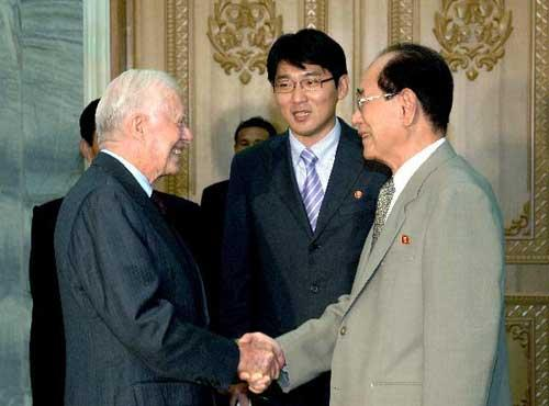 This photo released by official news agency of the Democratic People's Republic of Korea (DPRK) KCNA shows Kim Yong Nam (R), president of the Presidium of the Supreme People's Assembly of the Democratic People's Republic of Korea (DPRK), meets with former U.S. president Jimmy Carter in Pyongyang, Aug. 25, 2010. (Xinhua/KCNA)