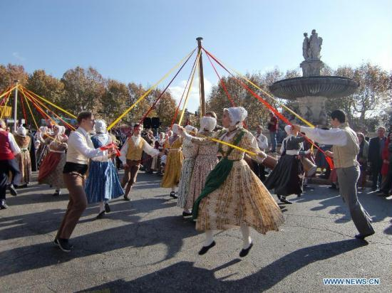 Sance France  City new picture : People clad in traditional clothes dance during an event held to greet ...