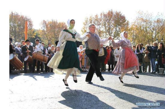 People In Traditional Clothes Dance During An Event Held To Greet Christmas Aix En Provence South France Nov 27 2011 Xinhua Wei