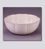 定窑白釉刻花葵瓣碗