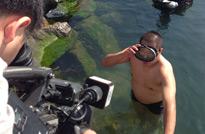 大连旅顺口摄像老师和出镜主持一起体验海上旅顺的的水下风情