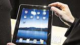 """联通锁iPhone引发热议 iPad又被中移动""""捆绑"""""""