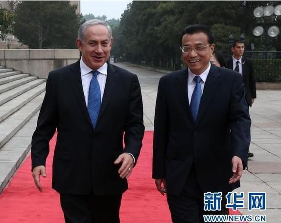 5月8日,中国国务院总理李克强在北京人民大会堂东门外广场为以色列总理内塔尼亚胡举行欢迎仪式。 新华社记者 庞兴雷 摄