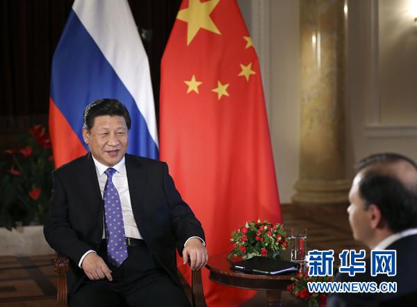2月7日,国家主席习近平在俄罗斯索契接受俄罗斯电视台专访。新华社记者 兰红光 摄
