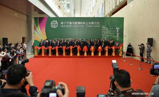 A ribbon-cutting ceremony is held to mark the opening of the exhibition Nuclear Industry China 2014 in Beijing, China, April 15, 2014. The four-day exhibition kicked off here Tuesday. Nearly 200 companies from 40 countries displayed their products developed in recent years. (Xinhua/Li Xin)