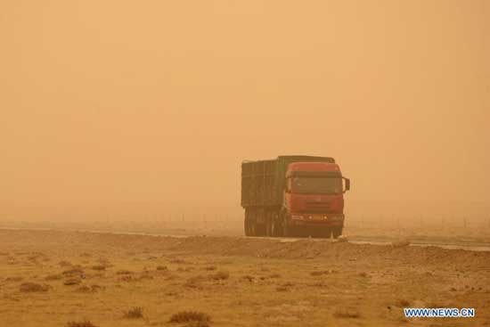 A truck runs in sand and dust in Urad Middle Banner of Bayan Nur, north China