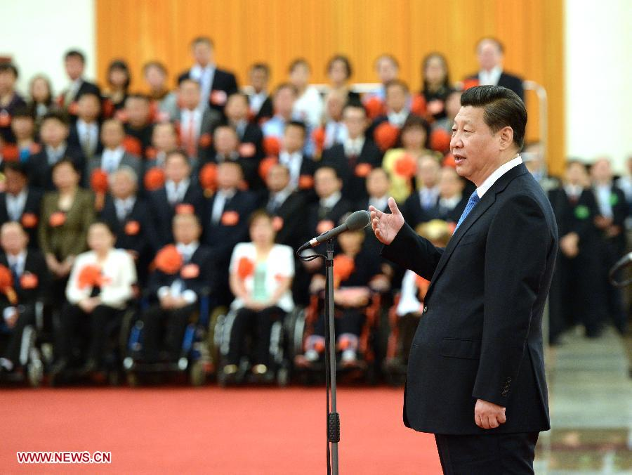 Chinese President Xi Jinping (front) speaks when meeting 165 disabled people who were honored as national role models for their self-reliance at the Great Hall of the People in Beijing, capital of China, May 16, 2014. Top chinese leaders Li Keqiang, Liu Yunshan and Zhang Gaoli also attended the ceremony. Also commended were 200 institutions and 133 individuals for help they had provided for the disabled. (Xinhua/Ma Zhancheng)