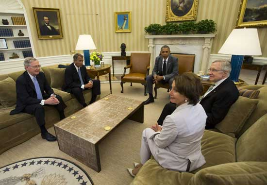 U.S. President Barack Obama (C) meets with Congressional leaders to discuss the situation in Iraq in the Oval Office of the White House in Washington June 18, 2014.
