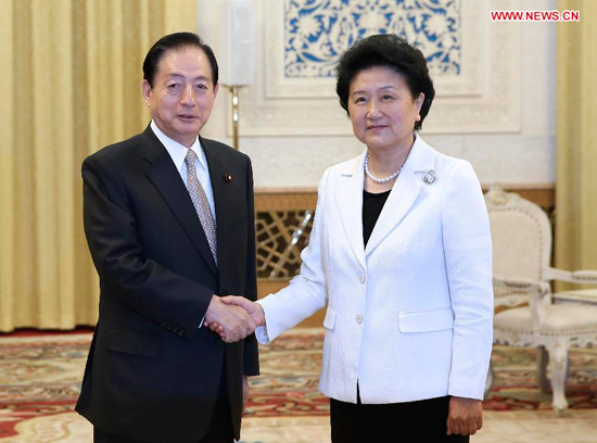 Chinese Vice Premier Liu Yandong (R) meets with Japanese Land, Infrastructure, Transport and Tourism Minister Akihiro Ota in Beijing, China, June 27, 2014. (Xinhua/Pang Xinglei)