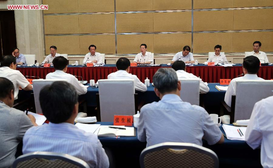 Chinese Vice Premier Zhang Gaoli (rear C), also a member of the Standing Committee of the Political Bureau of the Communist Party of China Central Committee, presides over a meeting with officials from provinces and autonomous regions including Shaanxi, Gansu, Qinghai, Ningxia and Xinjiang, in Lanzhou, capital of northwest China