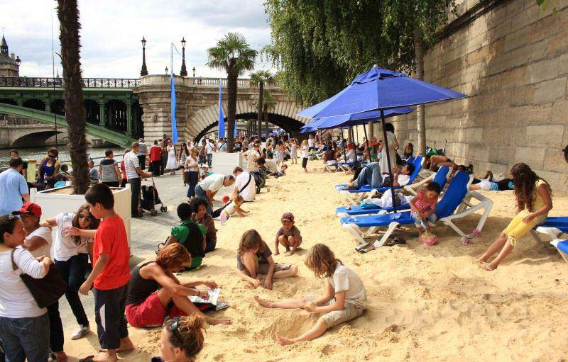 The city of Paris has opened its annual urban beach along the river Seine on Saturday, for tourists and locals to enjoy a bit of the seaside, right in the heart of the city.