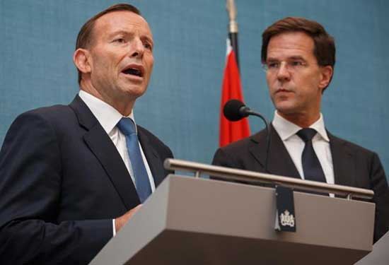 Australian Prime Minister Tony Abbott (L) gives a statement next to Dutch Prime Minister Mark Rutte at the Catshuis on August 11, 2014 in The Hague, Netherlands. Abbott is in the Netherlands for a one-day official visit to talk with Rutte and other Dutch officials about the ongoing investigation into the shooting down of flight MH17.