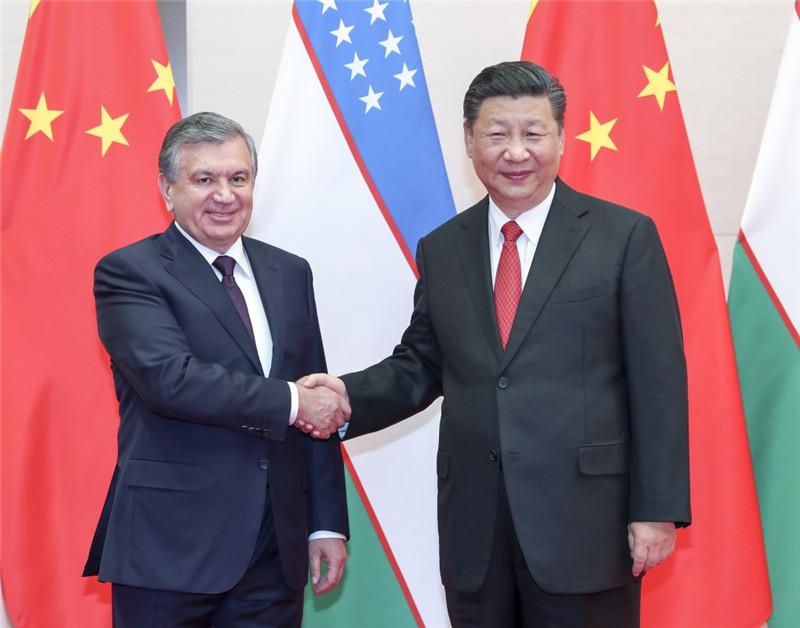 6月9日,国家主席习近平在青岛会见乌兹别克斯坦总统米尔济约耶夫。
