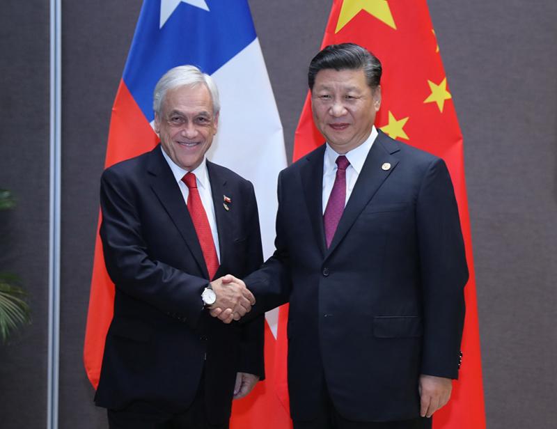 11月17日,国家主席习近平在莫尔兹比港会见智利总统皮涅拉。新华社记者 白雪飞 摄