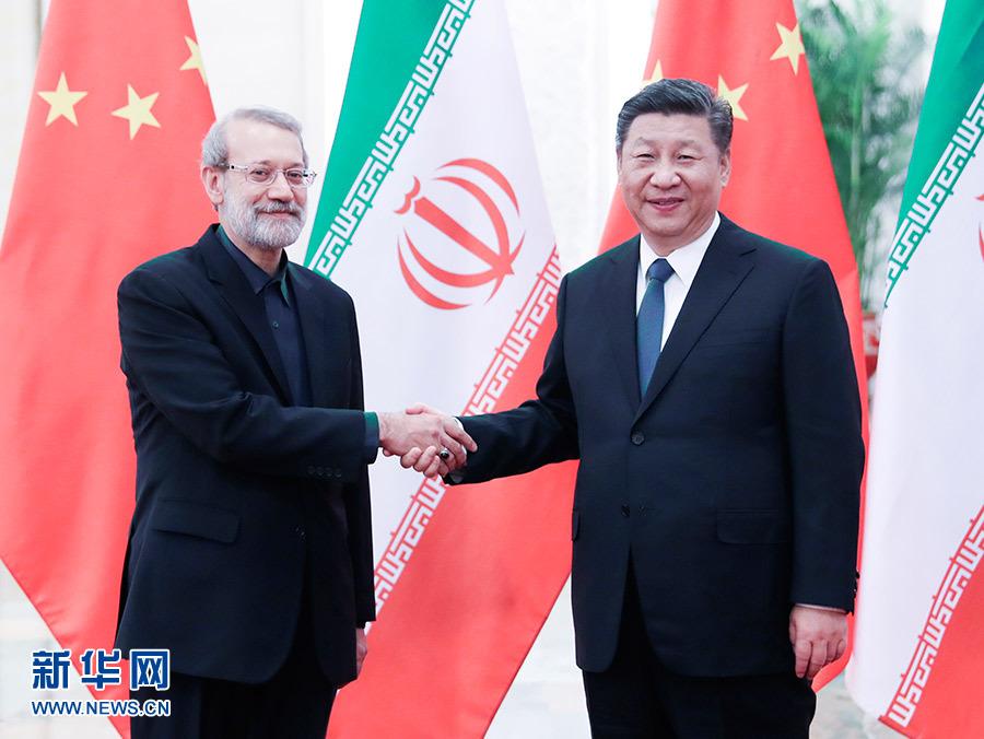2月20日,国家主席习近平在北京人民大会堂会见伊朗伊斯兰议会议长拉里贾尼。