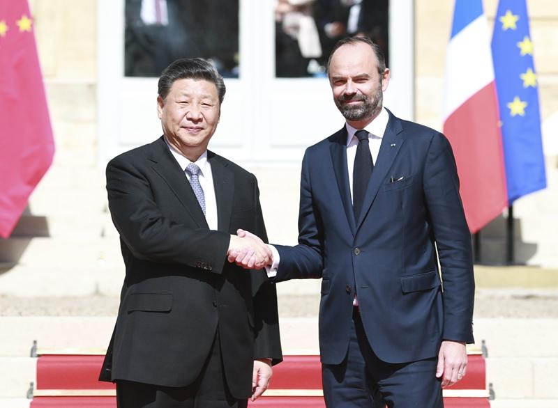 3月26日,国家主席习近平在巴黎总理府会见法国总理菲利普。
