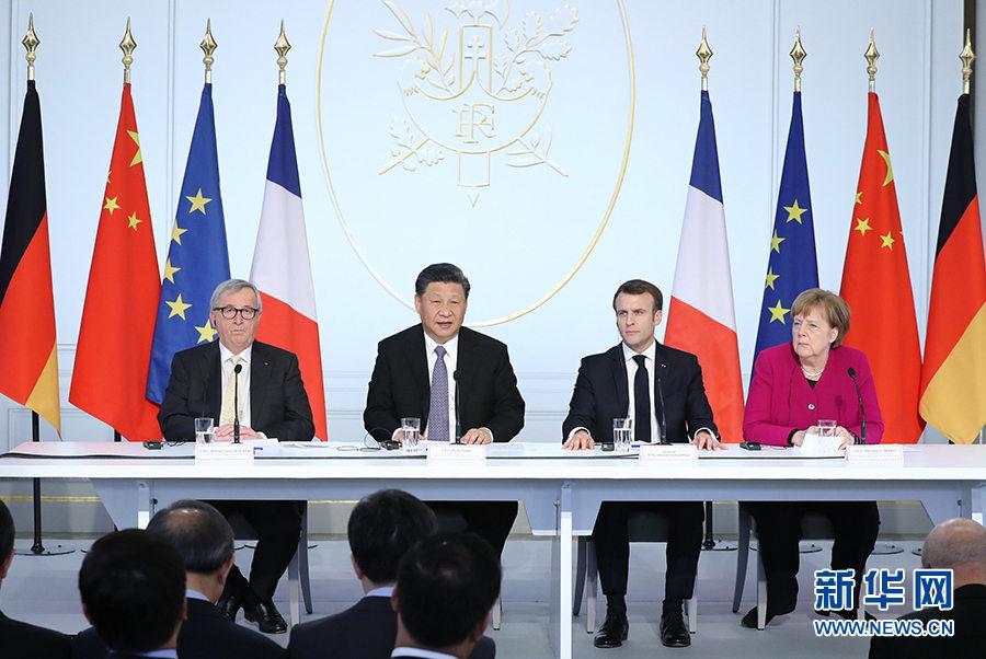 3月26日,国家主席习近平在巴黎同法国总统马克龙一道出席中法全球治理论坛闭幕式。德国总理默克尔、欧盟委员会主席容克应邀出席。新华社记者 鞠鹏 摄