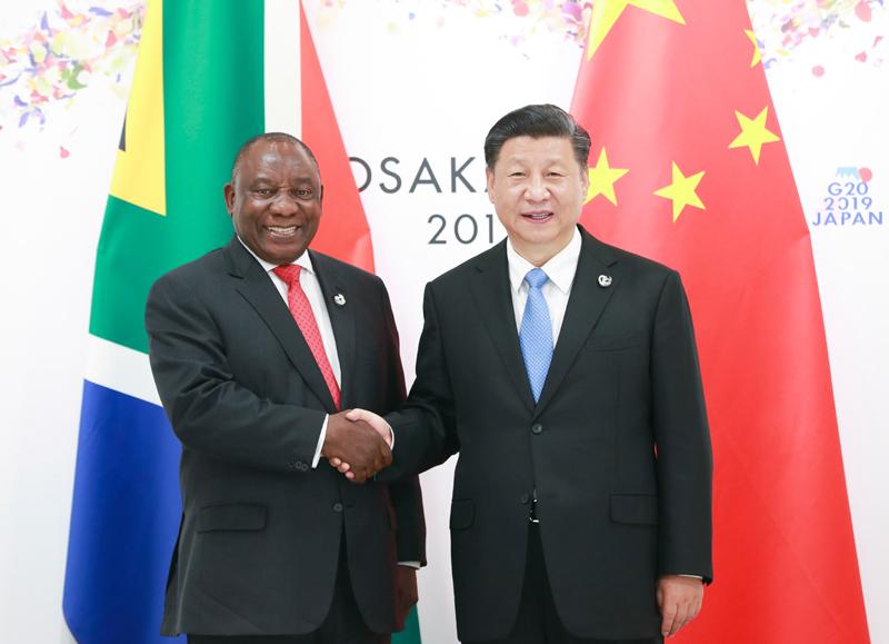 6月28日,国家主席习近平在大阪会见南非总统拉马福萨。新华社记者 庞兴雷 摄