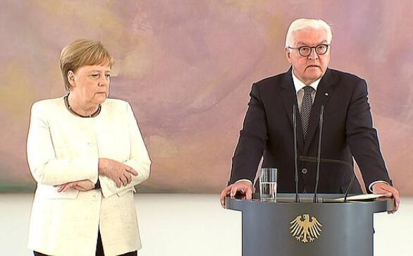 6月27日,站在德国总统施泰因迈尔旁边的默克尔再次出现浑身发抖的情况