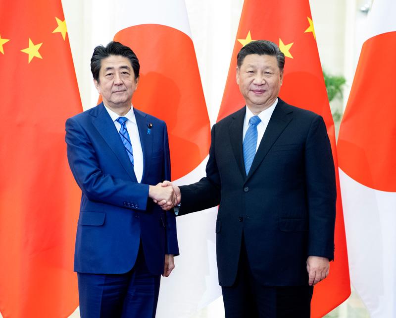 12月23日,国家主席习近平在北京人民大会堂会见日本首相安倍晋三。新华社记者 李学仁 摄