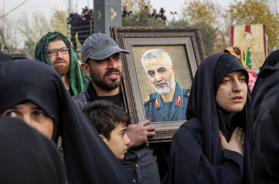 A man holds a picture of top Iranian commander Qasem Soleimani during a protest in Tehran, Iran, on Jan. 3, 2020. (Photo by Ahmad Halabisaz/Xinhua)