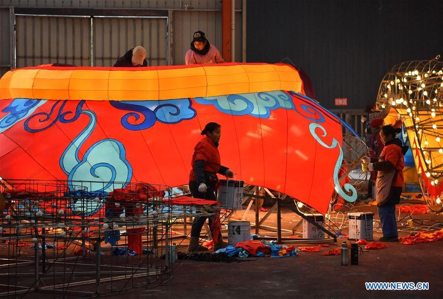 Workers make a large colored lantern at a factory in Xuan