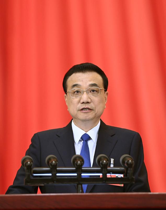 5月22日,第十三届全国人民代表大会第三次会议在北京人民大会堂开幕。国务院总理李克强代表国务院向大会作政府工作报告。新华社记者 申宏 摄