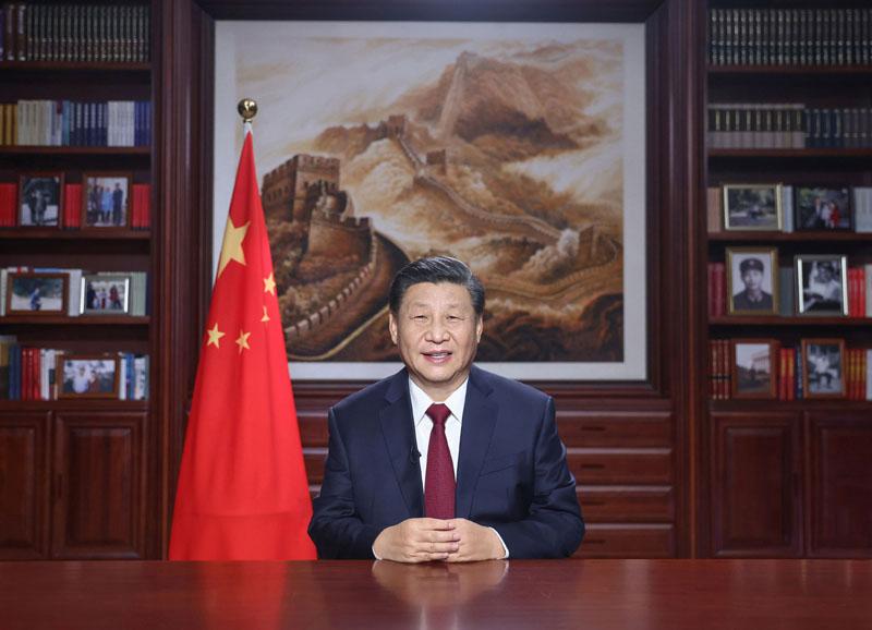 新年前夕,國家主席習近平通過中央廣播電視總臺和互聯網,發表二〇二一年新年賀詞。新華社記者 鞠鵬 攝