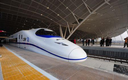 A high-speed train runs out of the Wuhan Railway Station in Wuhan, capital of central China's Hubei Province, Dec. 26, 2009. The Wuhan-Guangzhou high-speed railway, which boasts of the world's fastest train journey with a 350-km-per-hour average speed, is debuted on Saturday. (Xinhua/Cheng Min)