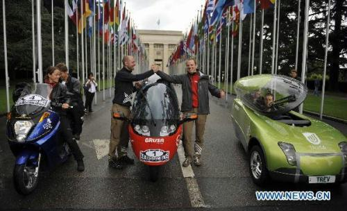 Drivers with their autos from Germany, Switzerland and Australia (from L to R) wait for the start of the Zero Race in front of the Palace of Nations in Geneva, Switzerland, Aug. 16, 2010. Four Teams from German, Switzerland, Australia and South Korea begin the race with their zero emission autos. The Zero Race will last 80 days and cover a distance of 30,000 kilometres in 150 cities of 16 countries and regions, including China's Shanghai. (Xinhua/Yu Yang)