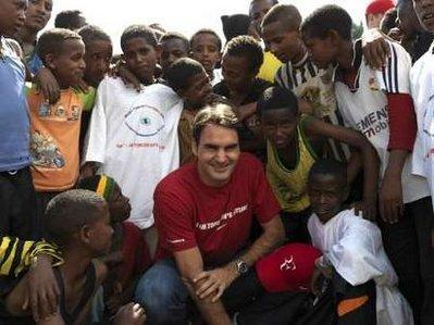 REFILE- REMOVING RESTRICTIONS Tennis player Roger Federer of Switzerland poses with students at a primary school, funded by his charity, the Roger Federer Foundation, in Kore Roba February 12, 2010. Federer was in Ethiopia for a one-day visit to see the work his charity does.REUTERS